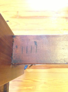 """The original maker's mark of """"4"""" to identify matching posts and rails to help in putting the bed back together when taken apart."""